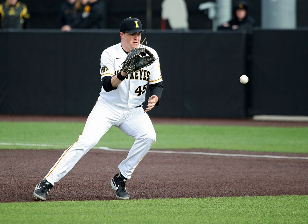 Iowa first baseman Peyton Williams (45) fields a ball before tossing it to first for an out during the seventh inning of their college baseball game at Duane Banks Field in Iowa City on Wednesday, March 11, 2020. (Stephen Mally/hawkeyesports.com)