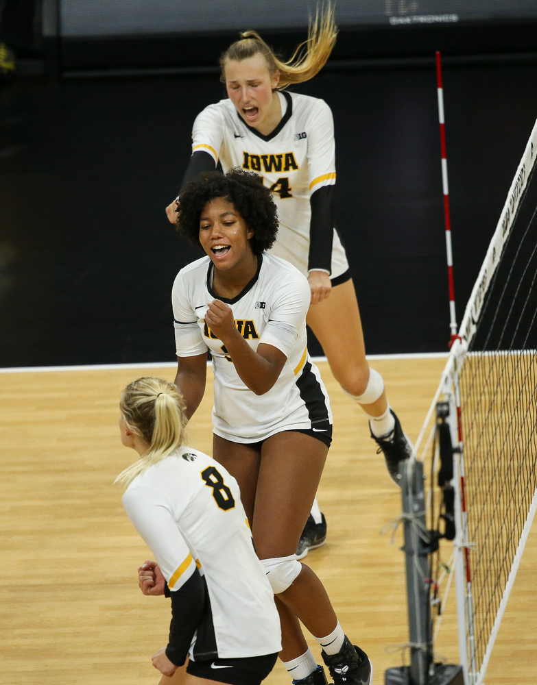 Iowa Hawkeyes middle blocker Amiya Jones (9) reacts after winning a point during a game against Purdue at Carver-Hawkeye Arena on October 13, 2018. (Tork Mason/hawkeyesports.com)