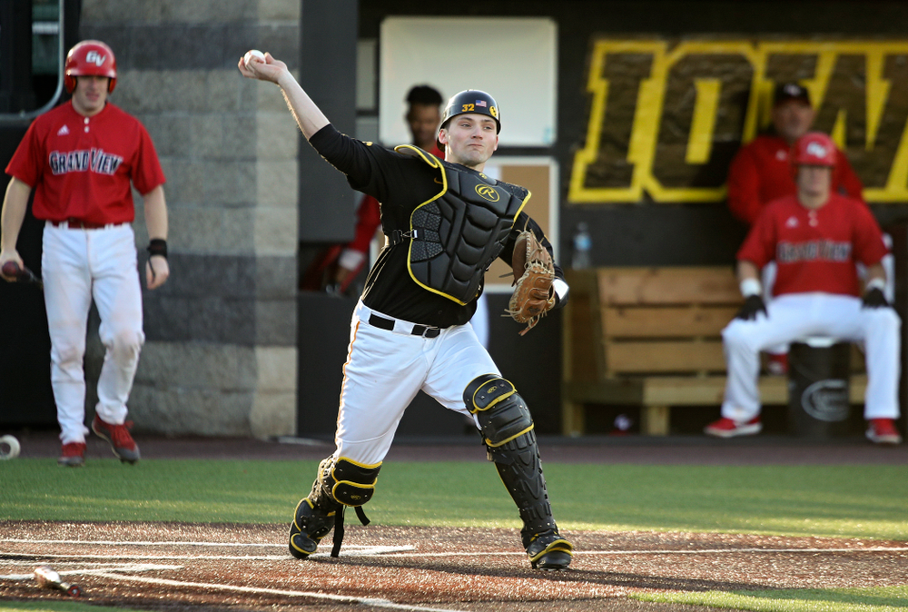 Iowa catcher Brett McCleary (32) throws to first for an out during the third inning of their game at Duane Banks Field in Iowa City on Tuesday, March 3, 2020. (Stephen Mally/hawkeyesports.com)