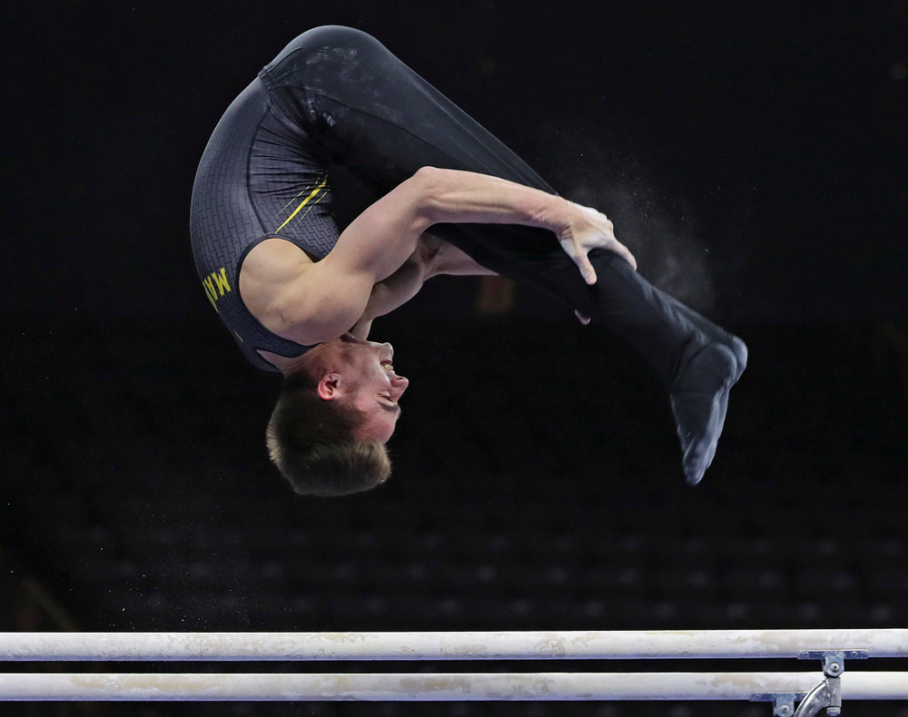 Iowa's Mitch Mandozzi competes in the parallel bars during the first day of the Big Ten Men's Gymnastics Championships at Carver-Hawkeye Arena in Iowa City on Friday, Apr. 5, 2019. (Stephen Mally/hawkeyesports.com)