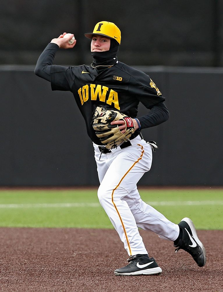Iowa Hawkeyes third baseman infielder Brendan Sher (2) throws to first for an out during the first inning of their game against Illinois at Duane Banks Field in Iowa City on Saturday, Mar. 30, 2019. (Stephen Mally/hawkeyesports.com)