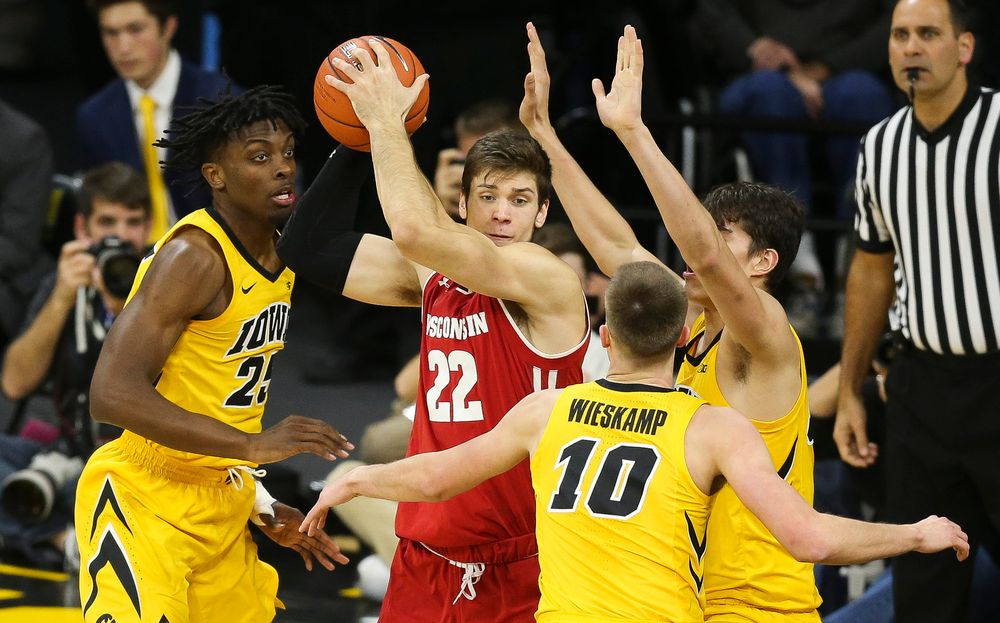 Iowa Hawkeyes forward Tyler Cook (25), Iowa Hawkeyes guard Joe Wieskamp (10) and Iowa Hawkeyes forward Luka Garza (55) trap Wisconsin's Ethan Happ on November 30, 2018 at Carver-Hawkeye Arena. (Tork Mason/hawkeyesports.com)