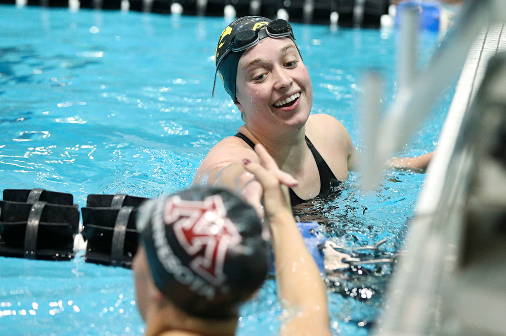Iowa's Kelsey Drake shakes hands with Minnesota's Tevyn Waddell after swimming the women's 100 yard butterfly final event during the 2020 Women's Big Ten Swimming and Diving Championships at the Campus Recreation and Wellness Center in Iowa City on Friday, February 21, 2020. (Stephen Mally/hawkeyesports.com)