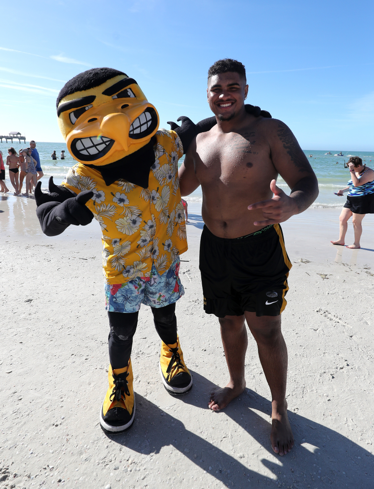 Herky The Hawk and Iowa Hawkeyes offensive lineman Tristan Wirfs (74) during the Outback Bowl Beach Day Sunday, December 30, 2018 at Clearwater Beach. (Brian Ray/hawkeyesports.com)