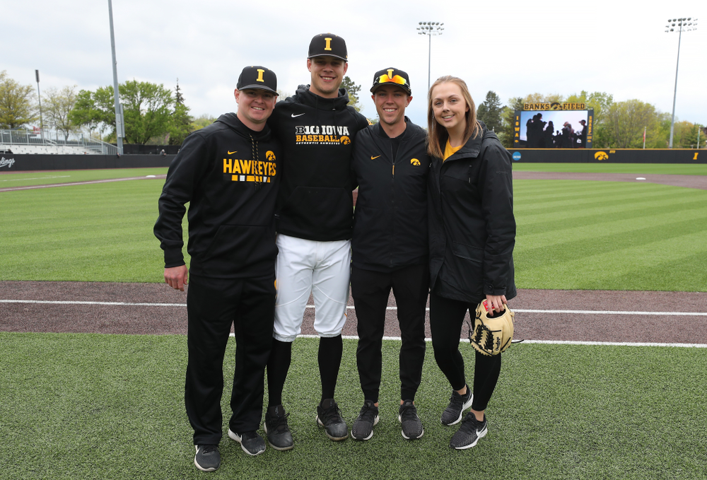 Iowa Hawkeyes Kyle Shimp (45) with senior managers T.J. Feldman, Jake Stone, and Haley Schulte before their game against Michigan State Sunday, May 12, 2019 at Duane Banks Field. (Brian Ray/hawkeyesports.com)
