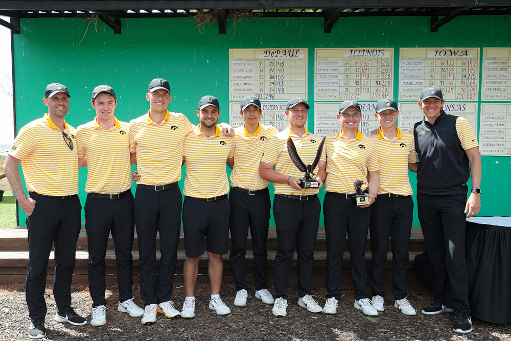 The Iowa Hawkeyes pose with their team trophy after winning the Hawkeye Invitational at Finkbine Golf Course in Iowa City on Sunday, Apr. 21, 2019. (Stephen Mally/hawkeyesports.com)