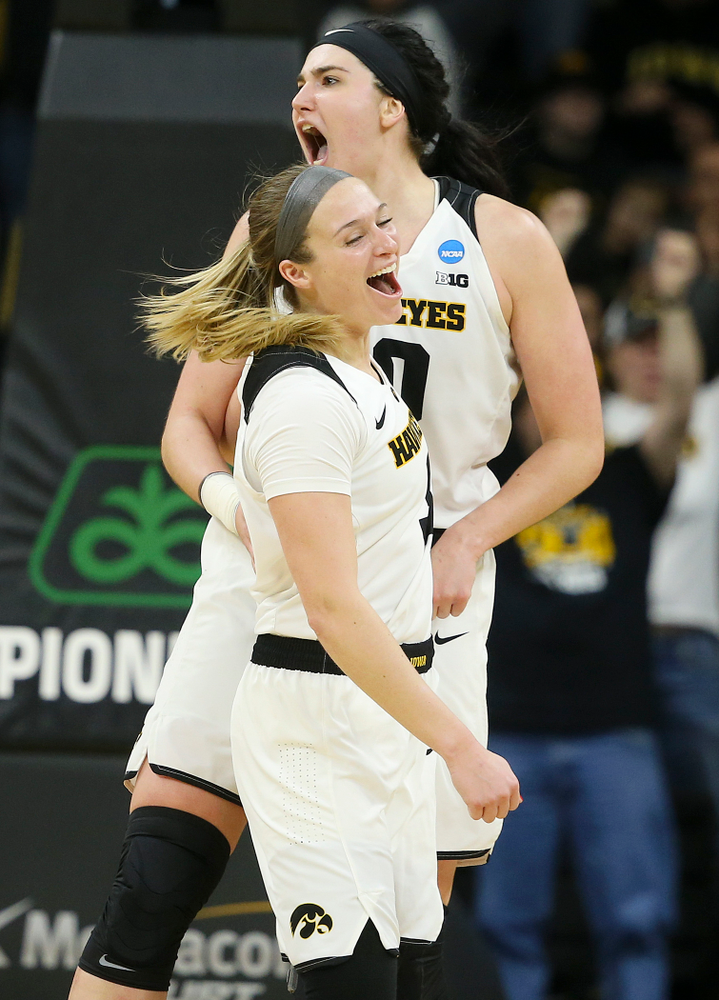 Iowa Hawkeyes guard Makenzie Meyer (3) and center Megan Gustafson (10) are pumped up during the fourth quarter of their second round game in the 2019 NCAA Women's Basketball Tournament at Carver Hawkeye Arena in Iowa City on Sunday, Mar. 24, 2019. (Stephen Mally for hawkeyesports.com)