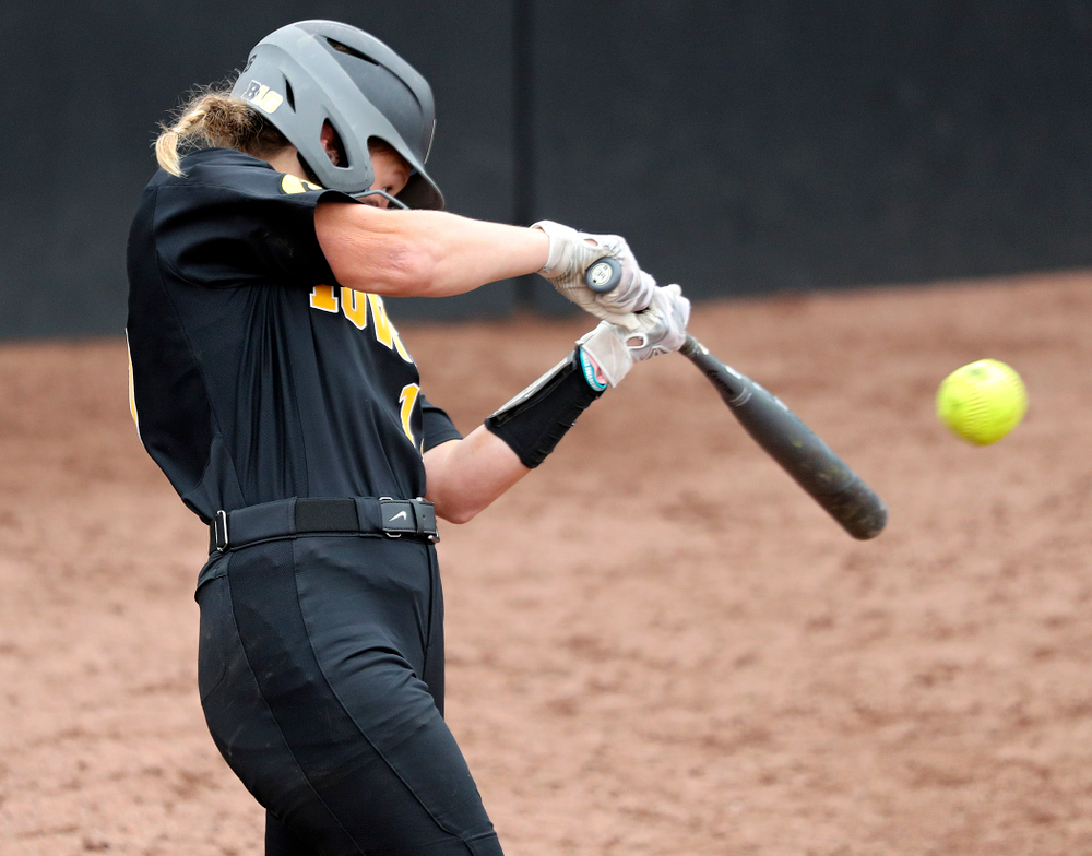Iowa's Kit Rocco (17) hits an RBI double during the sixth inning of their game against Iowa Softball vs Indian Hills Community College at Pearl Field in Iowa City on Sunday, Oct 6, 2019. (Stephen Mally/hawkeyesports.com)