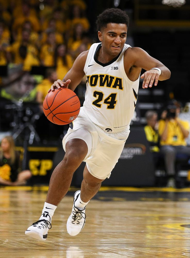 Iowa Hawkeyes guard Nicolas Hobbs (24) brings the ball upcourt during a game against Guilford College at Carver-Hawkeye Arena on November 4, 2018. (Tork Mason/hawkeyesports.com)