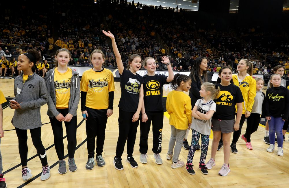 Female Athletes and participants in a youth clinic are recognized as part of National Girls and Women in Sports Day during the Iowa Hawkeyes game against Penn State Saturday, February 22, 2020 at Carver-Hawkeye Arena. (Brian Ray/hawkeyesports.com)