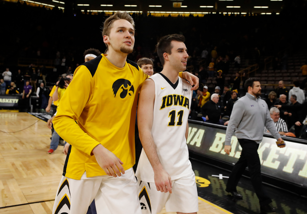 Iowa Hawkeyes forward Riley Till (20) and forward Charlie Rose (11)