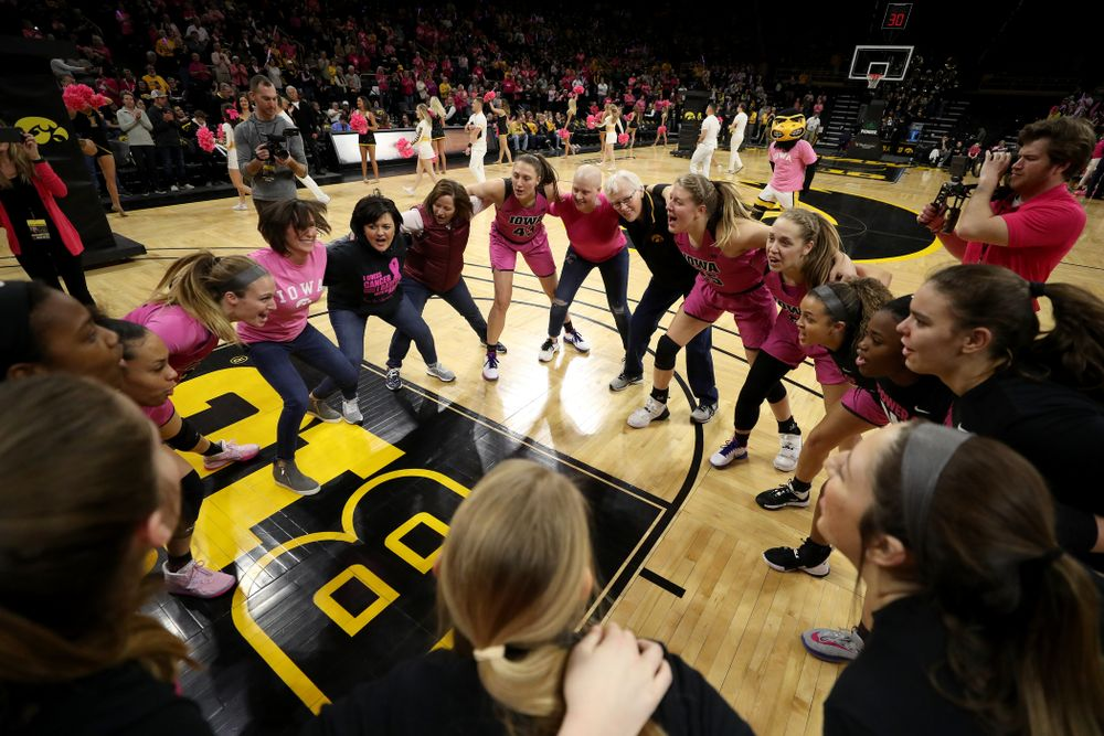 The Iowa Hawkeyes gather with women affected by breast cancer before their game against the Wisconsin Badgers Sunday, February 16, 2020 at Carver-Hawkeye Arena. (Brian Ray/hawkeyesports.com)