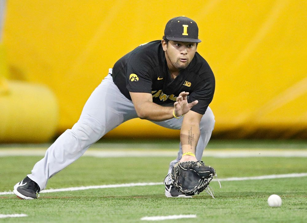 Iowa Hawkeyes infielder Izaya Fullard (20) fields a ball during practice at the Hansen Football Performance Center in Iowa City on Friday, January 24, 2020. (Stephen Mally/hawkeyesports.com)