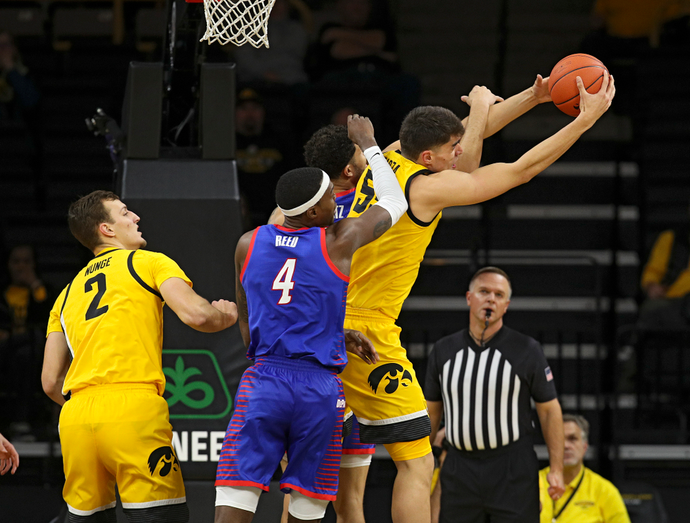 Iowa Hawkeyes center Luka Garza (55) pulls down a rebound during the first half of their game at Carver-Hawkeye Arena in Iowa City on Monday, Nov 11, 2019. (Stephen Mally/hawkeyesports.com)