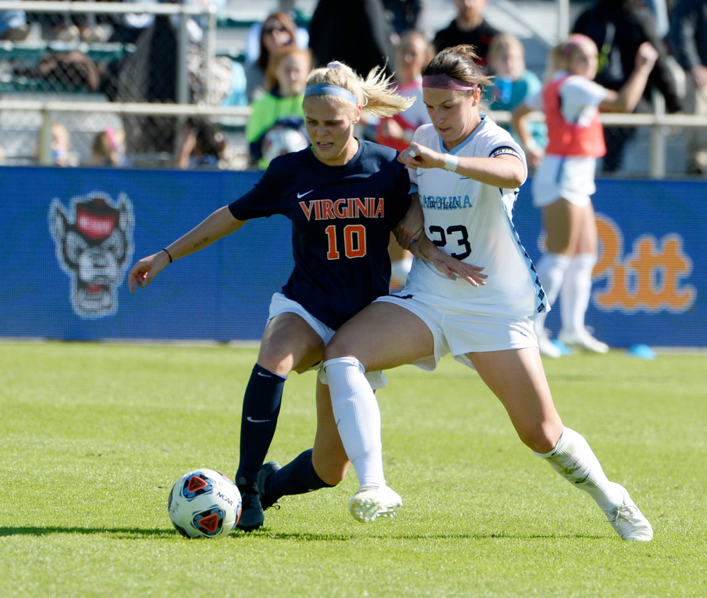 North Carolina's Lotte Wubben-Moy (23) pressures Virginia's Taryn Torres (10) during the 2019 ACC Women?s Soccer Championship at WakeMed Soccer Park in Cary, N.C., Sunday Nov. 10, 2019. (Photo by Sara D. Davis, the ACC)