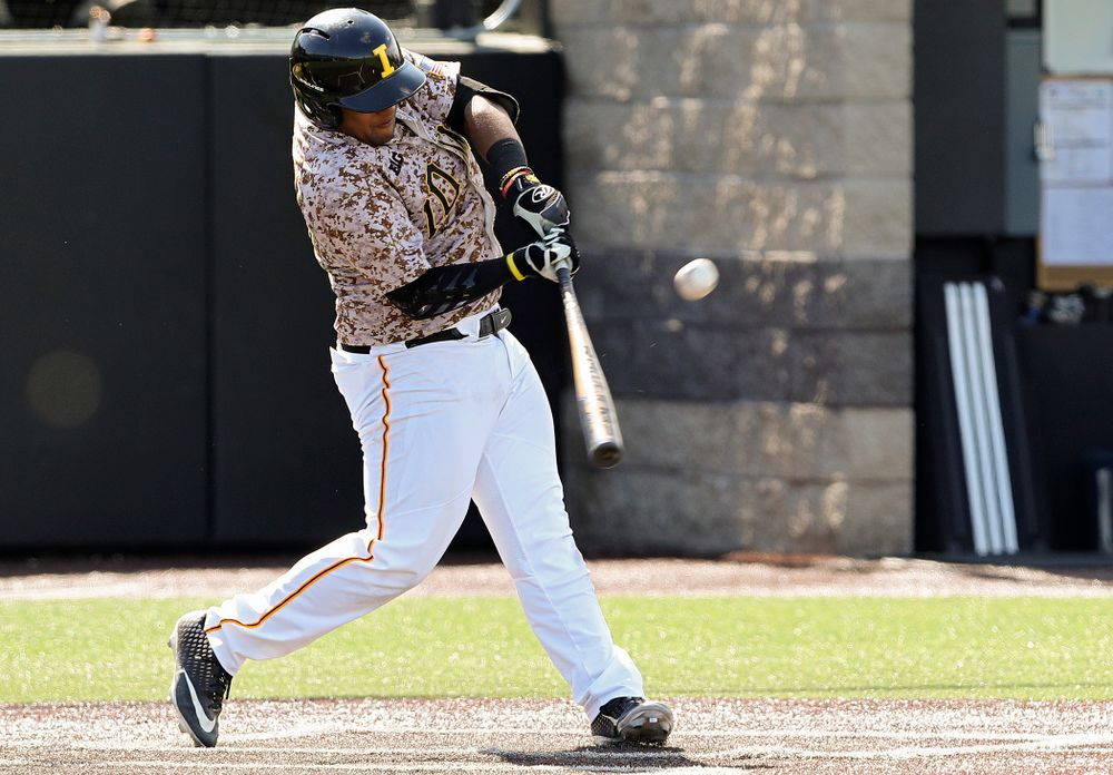 Iowa Hawkeyes second baseman Izaya Fullard (20) hits a sacrifice fly during the seventh inning of their game against UC Irvine at Duane Banks Field in Iowa City on Sunday, May. 5, 2019. (Stephen Mally/hawkeyesports.com)