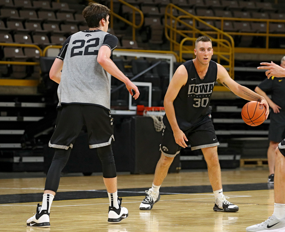 Iowa Hawkeyes guard Connor McCaffery (30) dribbles the ball as forward Patrick McCaffery (22) defends during practice at Carver-Hawkeye Arena in Iowa City on Monday, Sep 30, 2019. (Stephen Mally/hawkeyesports.com)