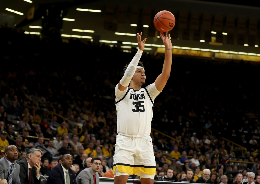 Iowa Hawkeyes forward Cordell Pemsl (35) makes his first career three point basket against the Maryland Terrapins Friday, January 10, 2020 at Carver-Hawkeye Arena. (Brian Ray/hawkeyesports.com)