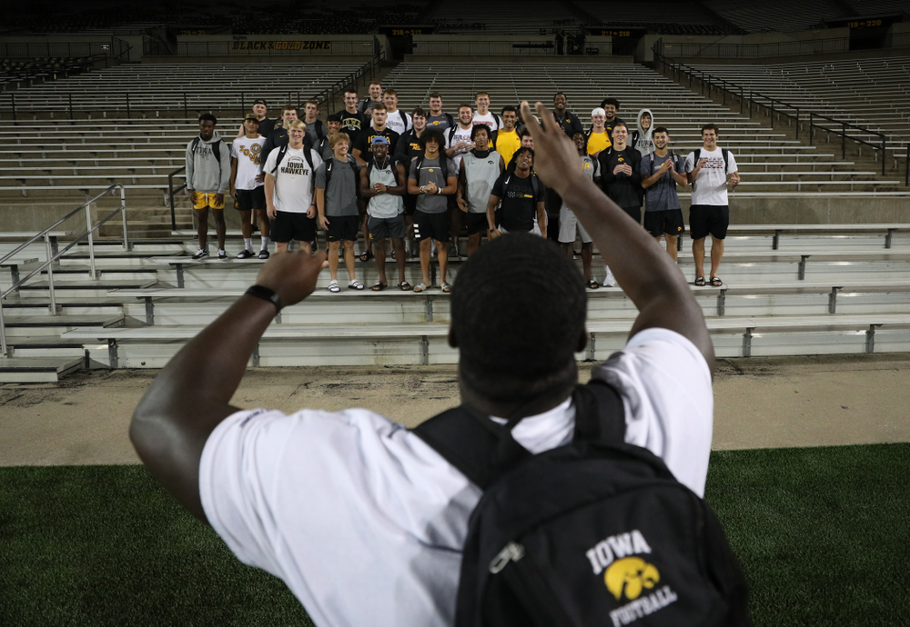 Iowa Hawkeyes defensive tackle Daviyon Nixon (54) leads the new players in the ÒFight SongÓ  Thursday, August 22, 2019 at Kinnick Stadium in Iowa City. (Brian Ray/hawkeyesports.com)