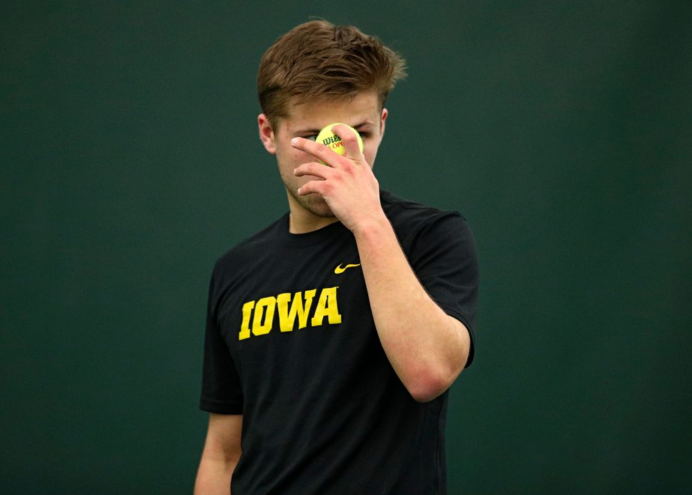 Iowa's Will Davies prepares to serve during his singles match at the Hawkeye Tennis and Recreation Complex in Iowa City on Friday, March 6, 2020. (Stephen Mally/hawkeyesports.com)