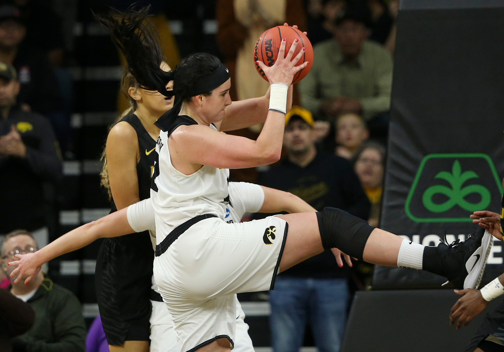 Iowa Hawkeyes center Megan Gustafson (10) pulls in a rebound during the third quarter of their second round game in the 2019 NCAA Women's Basketball Tournament at Carver Hawkeye Arena in Iowa City on Sunday, Mar. 24, 2019. (Stephen Mally for hawkeyesports.com)