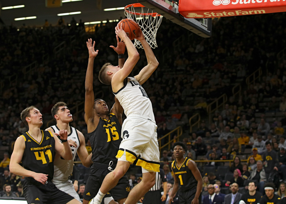 Iowa Hawkeyes guard Joe Wieskamp (10) scores a basket inside during the second half of their their game at Carver-Hawkeye Arena in Iowa City on Sunday, December 29, 2019. (Stephen Mally/hawkeyesports.com)