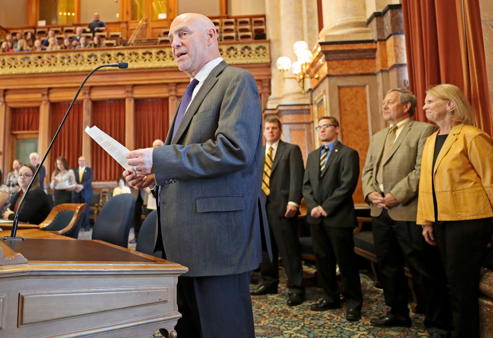 State Rep. Dave Jacoby (left) introduces House Resolution 22 to honor Iowa's Spencer Lee (center) in the House Chamber at the Iowa State Capitol Building on Tuesday, Apr. 9, 2019. (Stephen Mally/hawkeyesports.com)