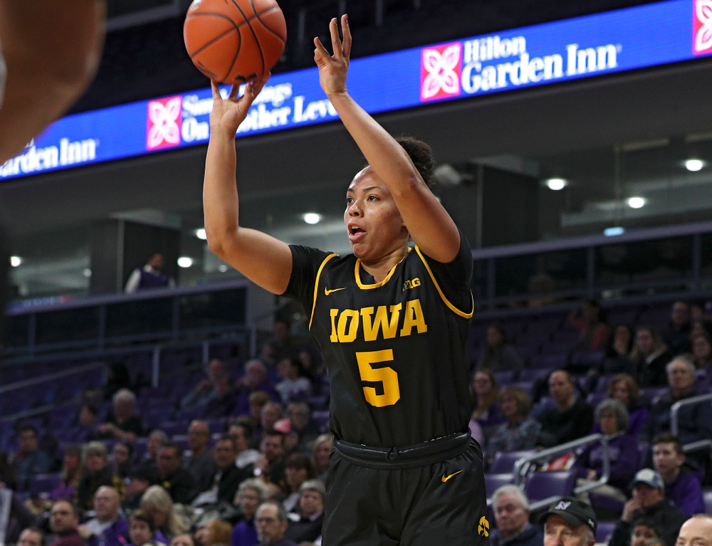 Iowa Hawkeyes guard Alexis Sevillian (5) makes a 3-pointer during the first quarter of their game at Welsh-Ryan Arena in Evanston, Ill. on Sunday, January 5, 2020. (Stephen Mally/hawkeyesports.com)