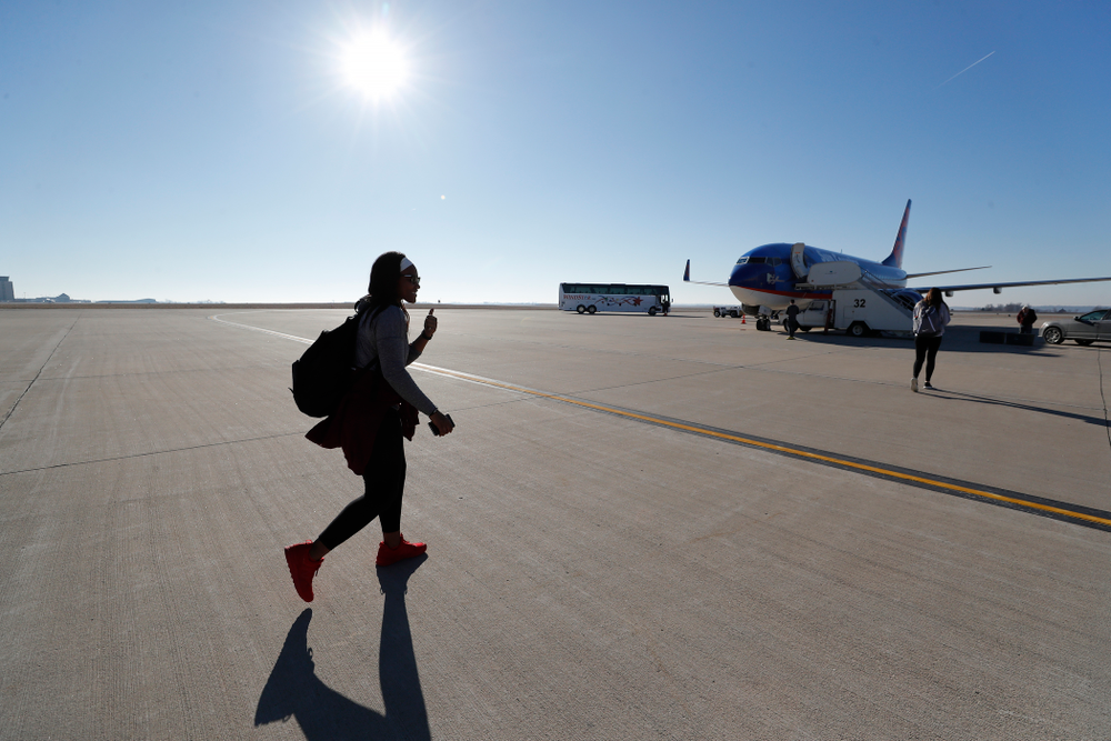 Iowa Hawkeyes guard Zion Sanders (24) walks to the team's plane as they travel to Los Angeles for the first round of the 2018 NCAA Tournament Thursday, March 15, 2018 at the Eastern Iowa Airport. (Brian Ray/hawkeyesports.com)