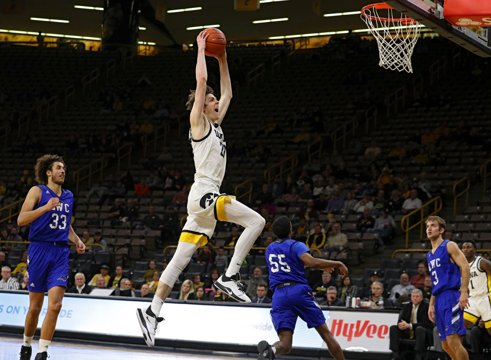 Iowa Hawkeyes forward Patrick McCaffery (22) dunks the ball during the second half of their exhibition game against Lindsey Wilson College at Carver-Hawkeye Arena in Iowa City on Monday, Nov 4, 2019. (Stephen Mally/hawkeyesports.com)