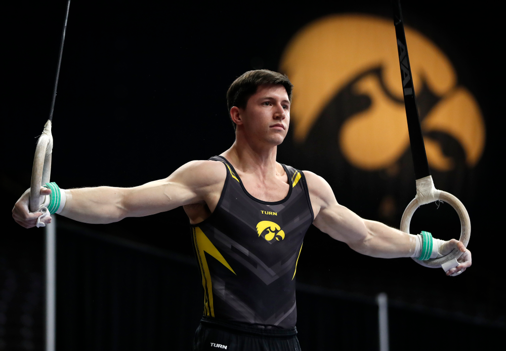 Mark Springette competes on the rings against Minnesota and Air Force