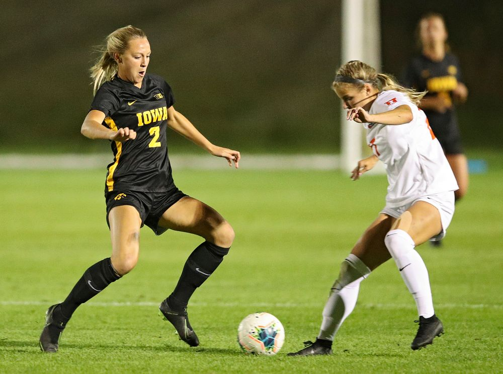 Iowa midfielder Hailey Rydberg (2) battles for position on the ball during the first half of their match against Illinois at the Iowa Soccer Complex in Iowa City on Thursday, Sep 26, 2019. (Stephen Mally/hawkeyesports.com)