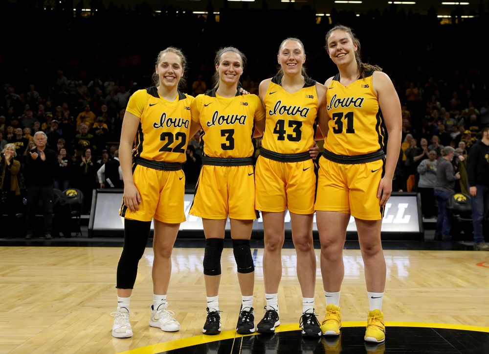 Iowa Hawkeyes guard Kathleen Doyle (22), guard Makenzie Meyer (3), forward Amanda Ollinger (43), and forward/center Paula Valiño Ramos (31) during senior day activities following their win over the Minnesota Golden Gophers Thursday, February 27, 2020 at Carver-Hawkeye Arena. (Brian Ray/hawkeyesports.com)