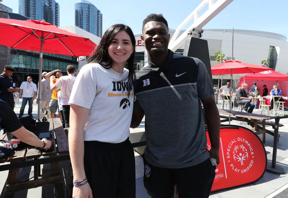 Iowa Hawkeyes forward Megan Gustafson (10) with DukeÕs Zion Williamson during a Special Olympics event Friday, April 12, 2019 as part of the ESPN College Basketball Awards in the XBOX Plaza at LA Live.  (Brian Ray/hawkeyesports.com)