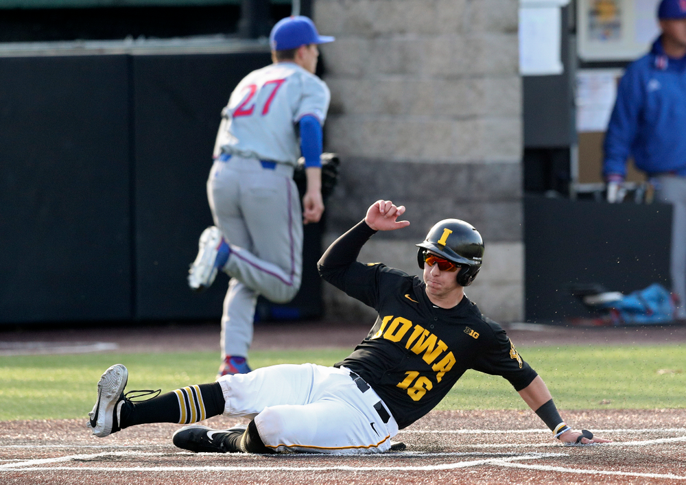 Iowa catcher Tyler Snep (16) scores a run during the fourth inning of their college baseball game at Duane Banks Field in Iowa City on Tuesday, March 10, 2020. (Stephen Mally/hawkeyesports.com)