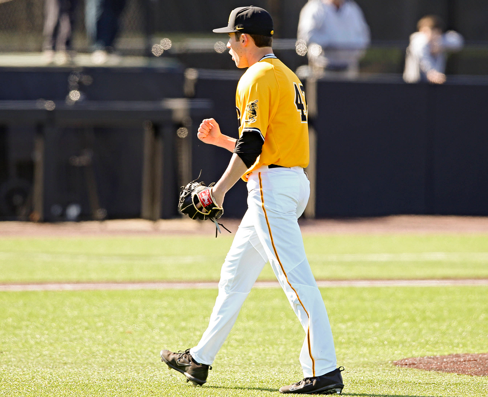 Iowa Hawkeyes pitcher Grant Leonard (43) celebrates after winning their game against Illinois at Duane Banks Field in Iowa City on Sunday, Mar. 31, 2019. (Stephen Mally/hawkeyesports.com)
