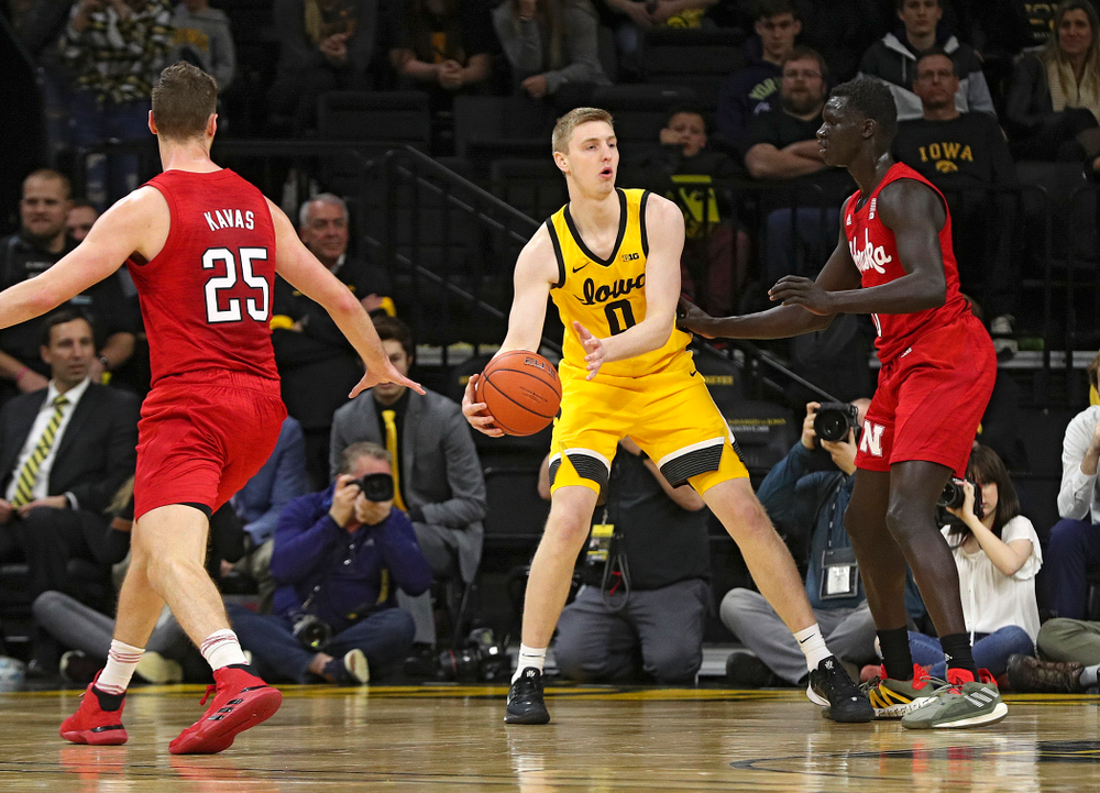 Iowa Hawkeyes forward Michael Baer (0) looks to pass during the second half of their game at Carver-Hawkeye Arena in Iowa City on Saturday, February 8, 2020. (Stephen Mally/hawkeyesports.com)