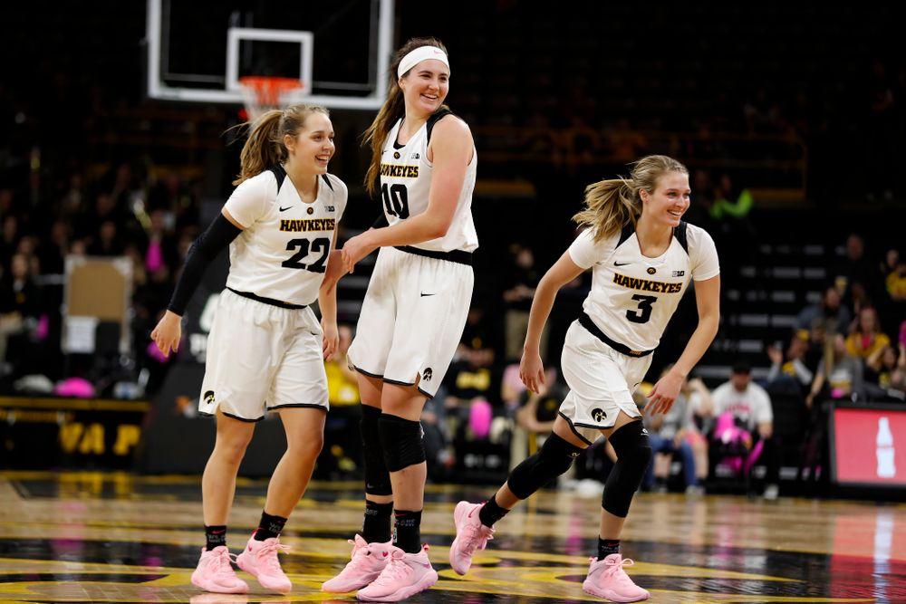 Iowa Hawkeyes guard Kathleen Doyle (22), forward Megan Gustafson (10), and guard Makenzie Meyer (3)