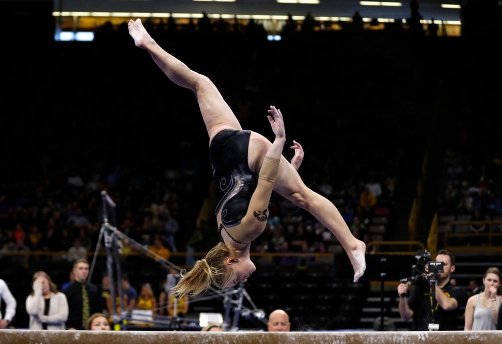 Iowa's Charlotte Sullivan competes on the beam against the Nebraska Cornhuskers