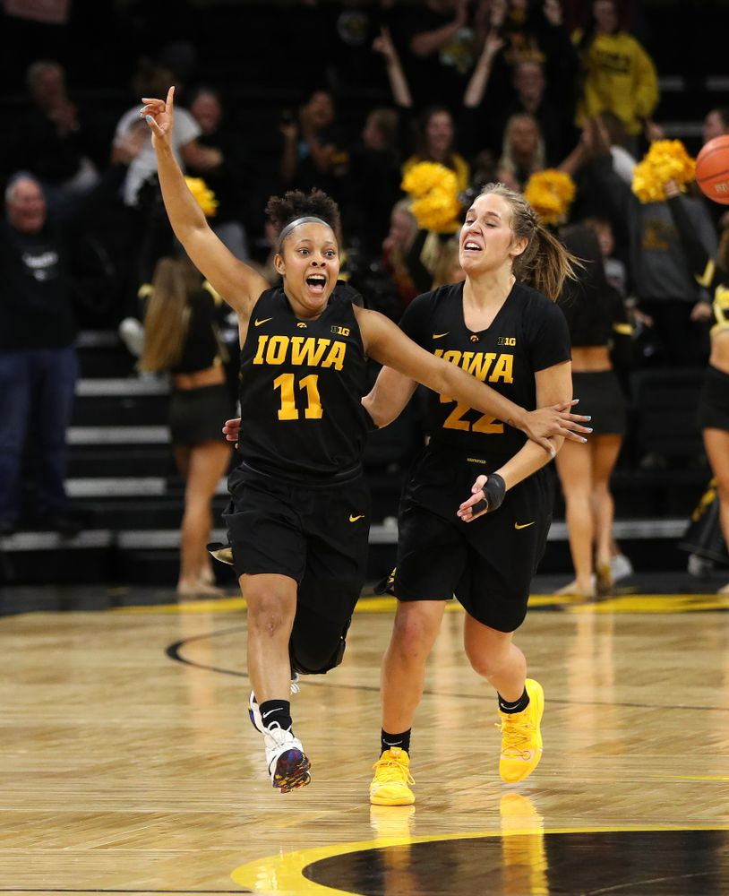 Iowa Hawkeyes guard Tania Davis (11) and guard Kathleen Doyle (22) celebrate their 73-70 win against the Iowa State Cyclones in the Iowa Corn Cy-Hawk Series Wednesday, December 5, 2018 at Carver-Hawkeye Arena. (Brian Ray/hawkeyesports.com)