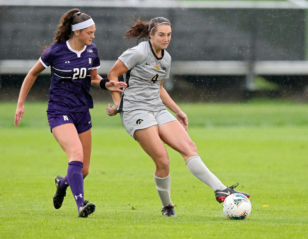 Iowa forward Kaleigh Haus (4) passes during the second half of their match at the Iowa Soccer Complex in Iowa City on Sunday, Sep 29, 2019. (Stephen Mally/hawkeyesports.com)