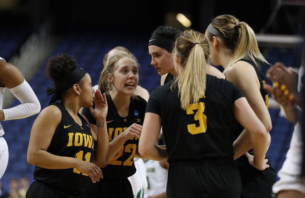 Iowa Hawkeyes guard Tania Davis (11), guard Kathleen Doyle (22), and forward Megan Gustafson (10) against the Baylor Lady Bears in the regional final of the 2019 NCAA Women's College Basketball Tournament Monday, April 1, 2019 at Greensboro Coliseum in Greensboro, NC.(Brian Ray/hawkeyesports.com)