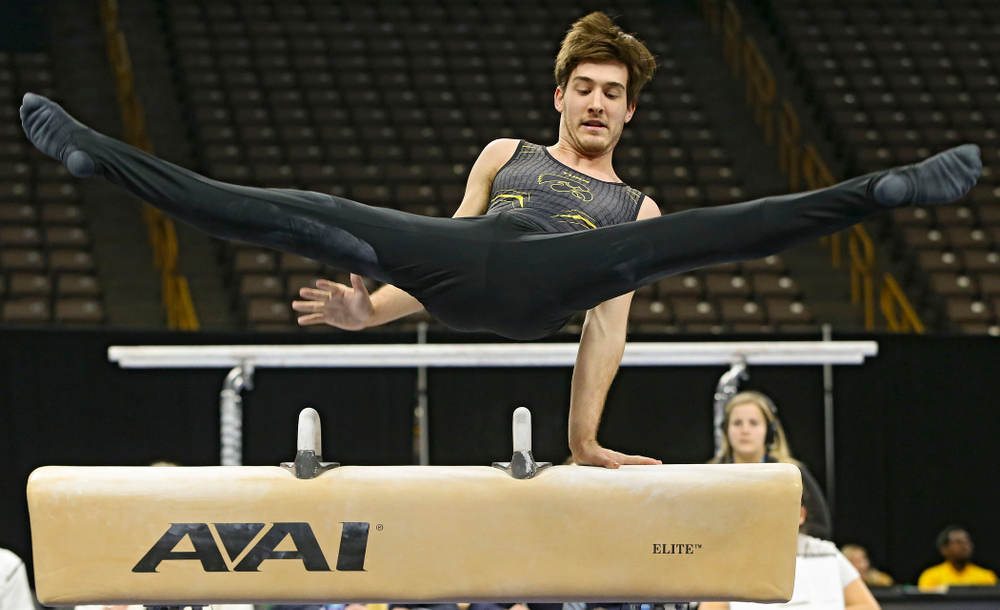 Iowa's Kevin Johnson competes in the pommel horse against Ohio State at Caver-Hawkeye Arena in Iowa City on Saturday, Mar. 16, 2019. (Stephen Mally for HawkeyeSports.com)
