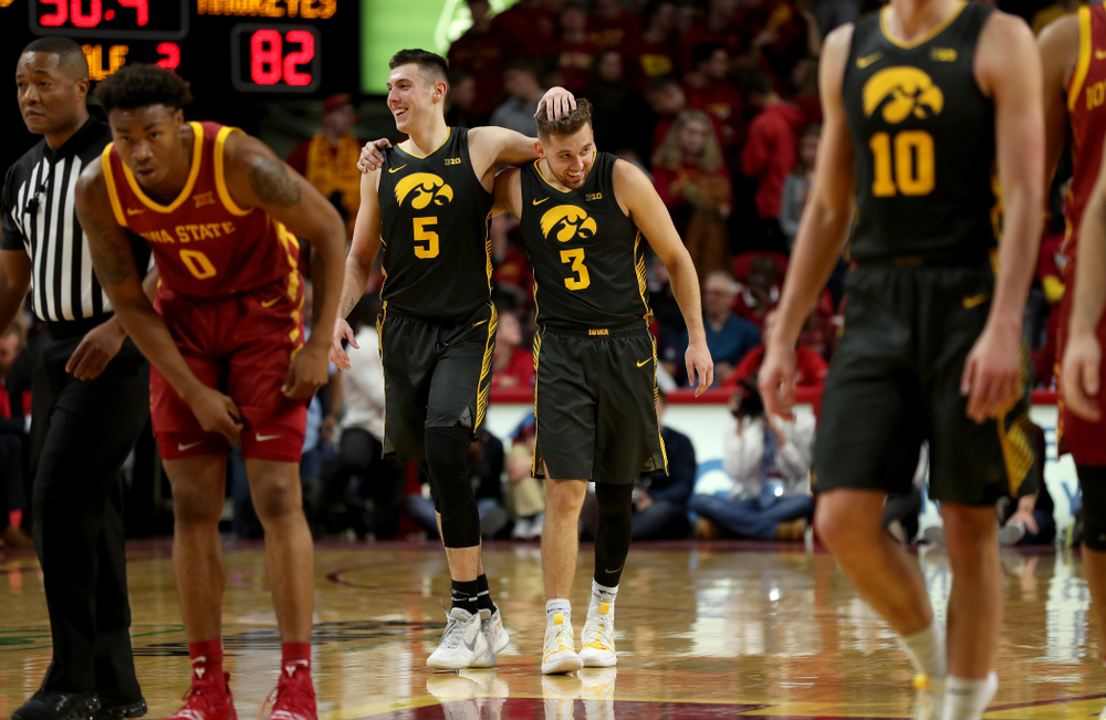 Iowa Hawkeyes guard CJ Fredrick (5) and guard Jordan Bohannon (3) against the Iowa State Cyclones Thursday, December 12, 2019 at Hilton Coliseum in Ames, Iowa(Brian Ray/hawkeyesports.com)