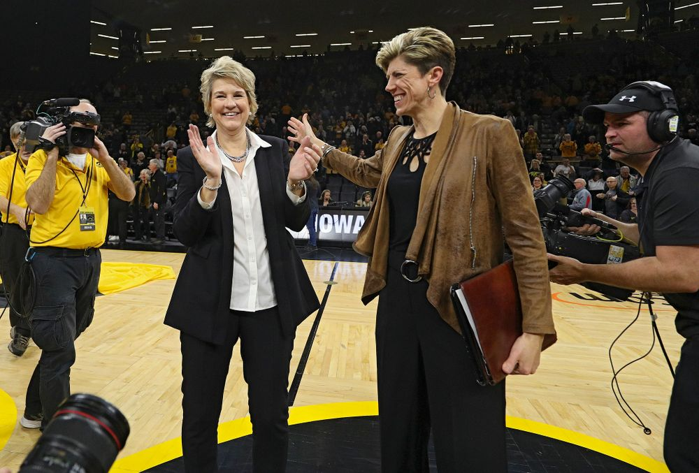 Iowa Hawkeyes head coach Lisa Bluder and associate head coach Jan Jensen after winning their game at Carver-Hawkeye Arena in Iowa City on Thursday, January 23, 2020. (Stephen Mally/hawkeyesports.com)
