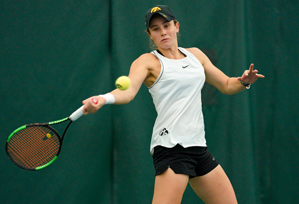 Iowa's Elise Van Heuvelen returns a shot during her doubles match at the Hawkeye Tennis and Recreation Complex in Iowa City on Sunday, February 16, 2020. (Stephen Mally/hawkeyesports.com)