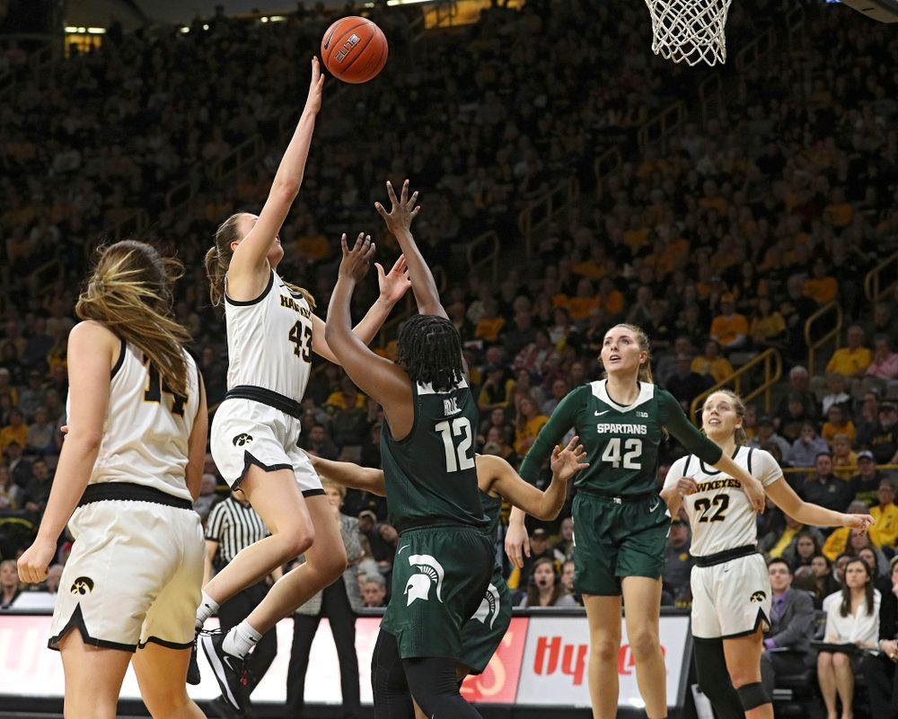 Iowa Hawkeyes forward Amanda Ollinger (43) makes a basket while being fouled during the fourth quarter of their game at Carver-Hawkeye Arena in Iowa City on Sunday, January 26, 2020. (Stephen Mally/hawkeyesports.com)