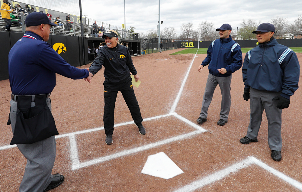 Iowa head coach Renee Gillispie greets the umpires before their game against Illinois at Pearl Field in Iowa City on Friday, Apr. 12, 2019. (Stephen Mally/hawkeyesports.com)