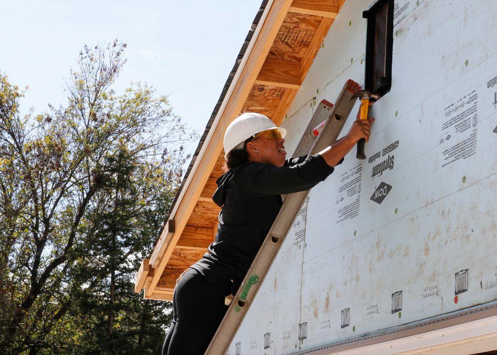 Iowa Hawkeyes guard Alexis Sevillian (5) works on the Habitat for Humanity Women's Build Wednesday, September 26, 2018 in Iowa City. (Brian Ray/hawkeyesports.com)