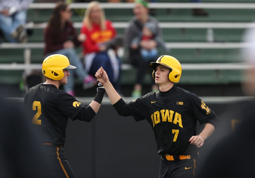 Iowa Hawkeyes Grant Judkins (7) and infielder Brendan Sher (2) against Simpson College Tuesday, March 19, 2019 at Duane Banks Field. (Brian Ray/hawkeyesports.com)